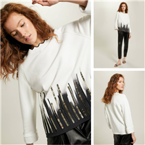 Knitwear enriched with precious details to give light to the classic black & white.