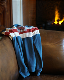 Our classic fit sweatshirt knitted with two thick racing stripes in ecru and red on a vintage blue ground, and finished with our archive woven Union Flag patch.